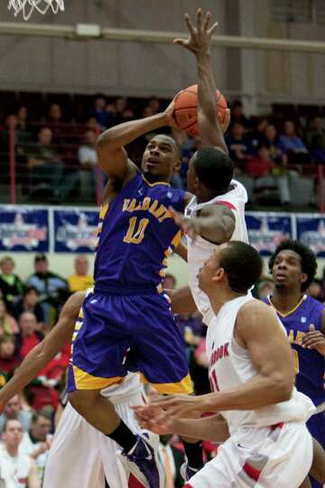 UAlbany's Mike Black drives the lane for a lay up as he is defended by Stony Brook's Anthony Jackson