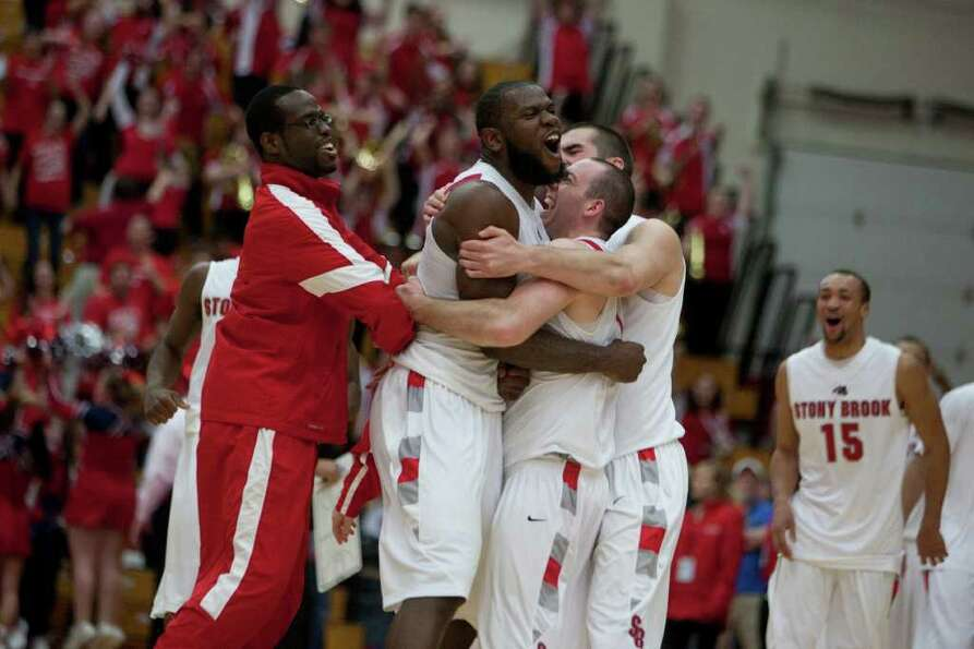 Stony Brook celebrates after the shot is counted at the end of the game, during the America East Men
