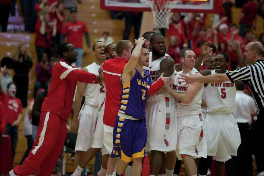 Jacob Iati (left) of UAlbany gets caught in the Stony Brook celebration as the Great Danes believed that the last shot did not count, during the America East Mens semifinal against Stony Brook at Chase Family Arena in Hartford, CT on March 4, 2012 (Shane Bufano/Special to the Times Union). Photo: Shane Bufano