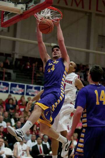 John Puk slams home a dunk for UAlbany, during the America East Mens semifinal against Stony Brook a