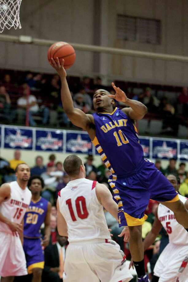 Mike Black of UAlbany attempts a layup during the America East Mens semifinal against Stony Brook at Chase Family Arena in Hartford, CT on March 4, 2012 (Shane Bufano/Special to the Times Union). Photo: Shane Bufano