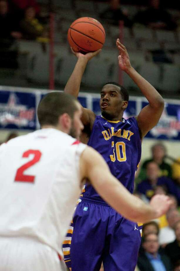 Jayson Guerrier of UAlbany nails a three-point shot for the Great Danes, during the America East Mens semifinal against Stony Brook at Chase Family Arena in Hartford, CT on March 4, 2012. Photo: Shane Bufano