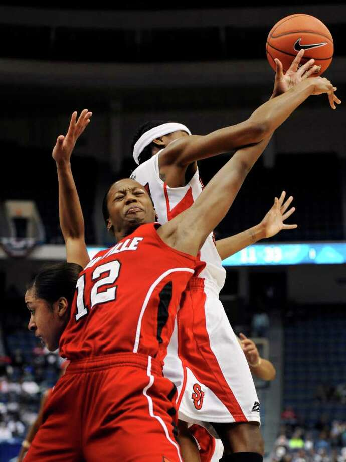 St. John's Da'Shena Stevens, left, Louisville's Shawnta' Dyer (12), and St. John's Shenneika Smith, right, battle for a rebound in the first half of an NCAA college basketball game in the quarterfinals of the Big East women's tournament in Hartford, Conn., Sunday, March 4, 2012. (AP Photo/Jessica Hill) Photo: Jessica Hill, Associated Press / AP2012