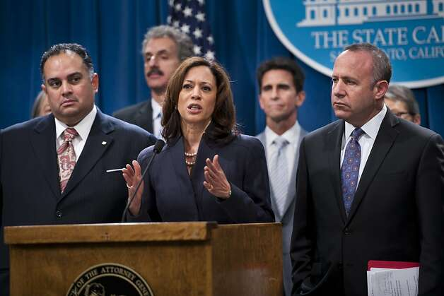 Attorney General Kamala D. Harris with legislative leaders Assembly Speaker John Perez, left, and Senate pro Tem Darrell Steinberg, right, unveil the California Homeowner Bill of Rights  at a press conference Wednesday, Feb. 29, 2012 in Sacramento, Calif., State Attorney General Kamala Harris promoted legislation Wednesday to reform the mortgage process in California and provide more protections for homeowners, three weeks after she secured $18 billion for California in a nationwide bank settlement.  (AP Photo/The Sacramento Bee, Paul Kitagaki Jr.)  MAGS OUT; TV OUT; MANDATORY CREDIT; NO SALES Photo: Paul Kitagaki Jr., Associated Press