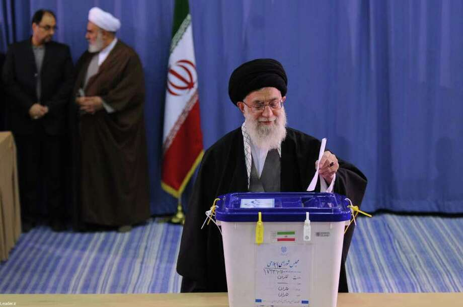"""A handout picture from an official website shows Iranian Supreme Leader Ayatollah Ali Khamenei casting his ballot during a parliamentary vote in Tehran on March 2, 2012. Iran voted for a new parliament in the first nationwide elections since a bitterly contested 2009 poll that returned President Mahmoud Ahmadinejad to power, posing a new test of his support among conservatives. AFP PHOTO/LEADER.IR/HO RESTRICTED TO EDITORIAL USE - MANDATORY CREDIT """"AFP PHOTO / HO /LEADER.IR"""" - NO MARKETING NO ADVERTISING CAMPAIGNS - DISTRIBUTED AS A SERVICE TO CLIENTS (Photo credit should read -/AFP/Getty Images) Photo: - / AFP"""