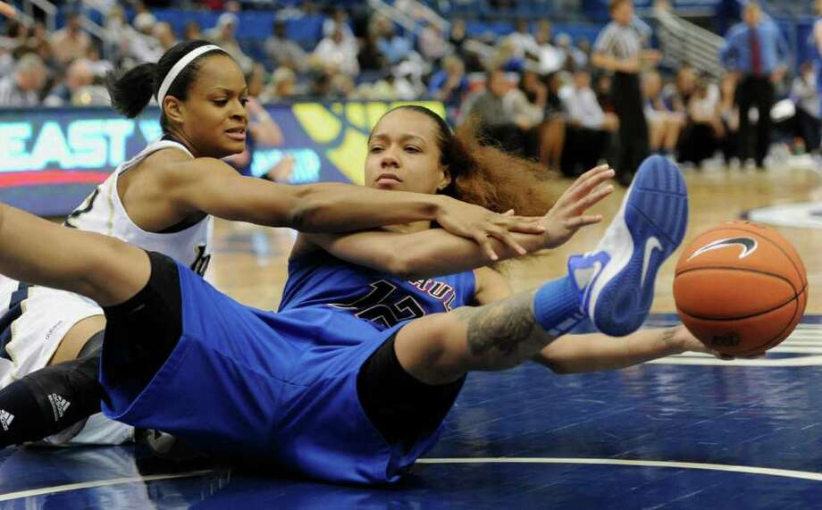 DePaul's Brittany Hrynko, right, keep the ball from Notre Dame's Fraderica Miller in the second half of an NCAA college basketball game in the quarterfinals of the Big East women's tournament in Hartford, Conn., Sunday, March 4, 2012. Notre Dame won 69-54. (AP Photo/Jessica Hill) Photo: Jessica Hill, Associated Press / AP2012