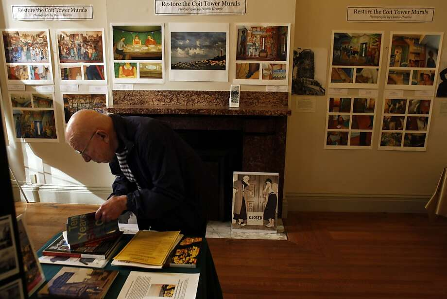 """Ralph Bergmann of San Rafael, looks through books at the San Francisco Mint on San Francisco's history, in front of a display for restoration of the Coit Tower murals. Ruth Gottstein, the 89-year old daughter of Coit Tower muralist Bernard Zakheim, promoted the restoration of the murals during the second annual San Francisco History Expo at the Old Mint in San Francisco, Calif., on Sunday, March 4, 2012. Gottstein told stories about the creation of the Coit Tower Murals in 1934, which she witnessed first-hand. Gottstein appears as a 12-year-old girl in Zakheim's Coit Tower mural """"The Library."""" Photo: Carlos Avila Gonzalez, The Chronicle"""