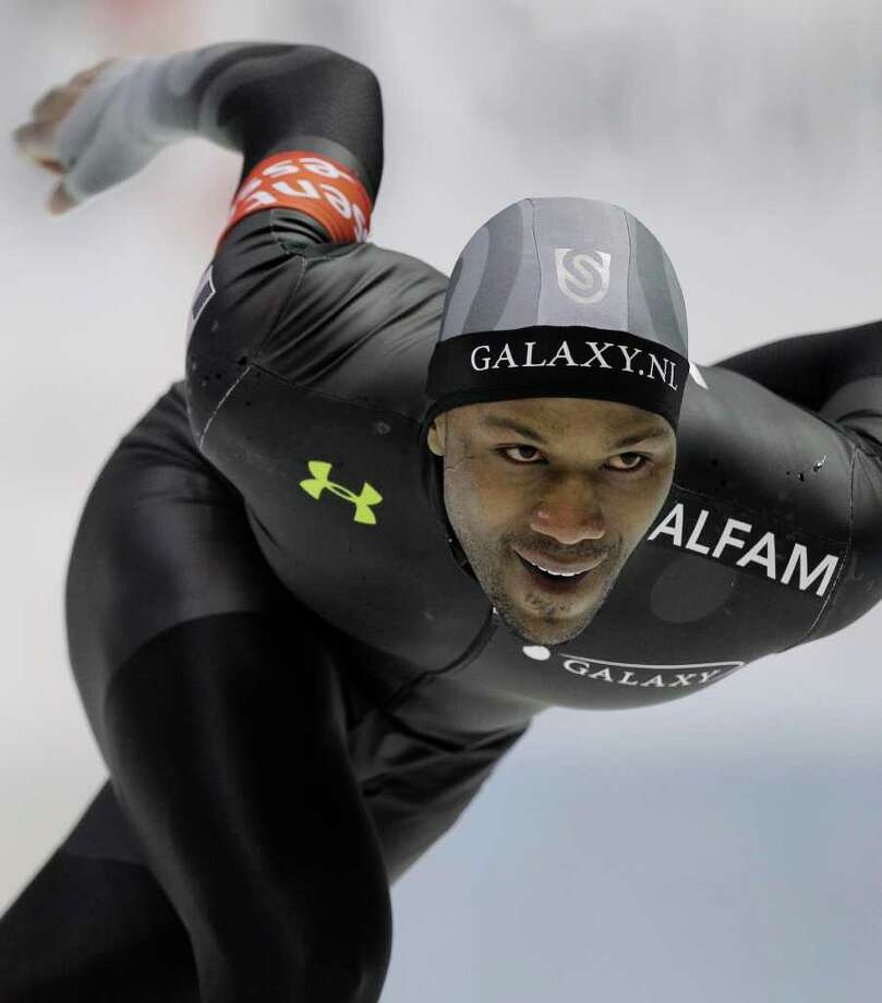 American Shani Davis competes during the men's 1000 meters race of the World Cup speed skating at Thialf Arena in Heerenveen, northern Netherlands, Sunday March 4, 2012. (AP Photo/Peter Dejong) Photo: PETER DEJONG