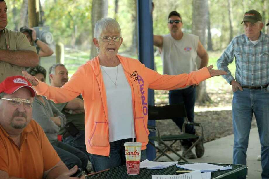 Cathie Naquin, 64, a resident of Patton Village since she was 12 years old, speaks to fellow residents during a community meeting on Sunday. Photo: Jerry Baker
