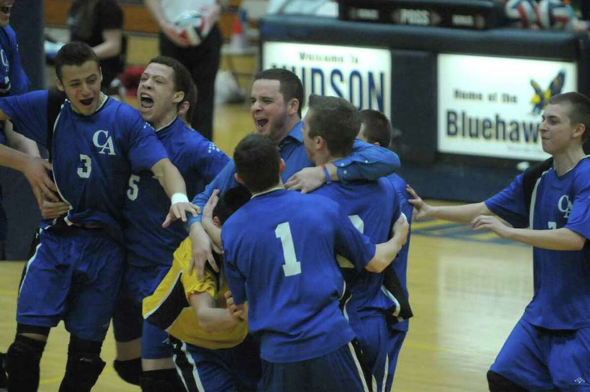Coxsackie-Athens players celebrate their win over Chatham during the Boy's Section II Class C/D Volleyball Championships on Sunday, March 4, 2012 at Hudson High School in Hudson, NY. (Paul Buckowski / Times Union)