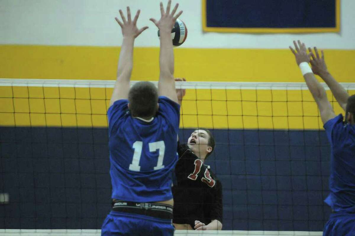 Brett Briski, left, of Coxsackie-Athens tries to block the shot of Chris Otto of Chatham during the Boy's Section II Class C/D Volleyball Championships on Sunday, March 4, 2012 at Hudson High School in Hudson, NY. (Paul Buckowski / Times Union)