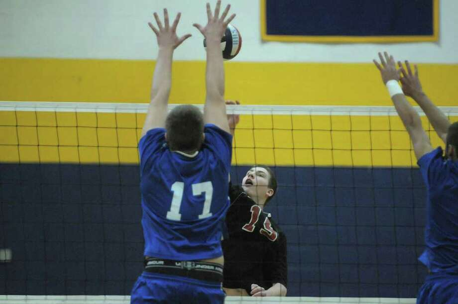 Brett Briski, left, of Coxsackie-Athens tries to block the shot of Chris Otto of Chatham during the Boy's Section II Class C/D Volleyball Championships on Sunday, March 4, 2012 at Hudson High School in Hudson, NY.  (Paul Buckowski / Times Union) Photo: Paul Buckowski