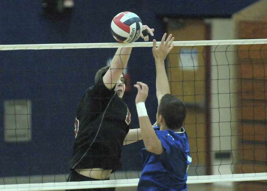 Trevor Melanson, left, of Chatham tries to get his shot past Brodie Kelly of Coxsackie-Athens  during the Boy's Section II Class C/D Volleyball Championships on Sunday, March 4, 2012 at Hudson High School in Hudson, NY.  (Paul Buckowski / Times Union) Photo: Paul Buckowski