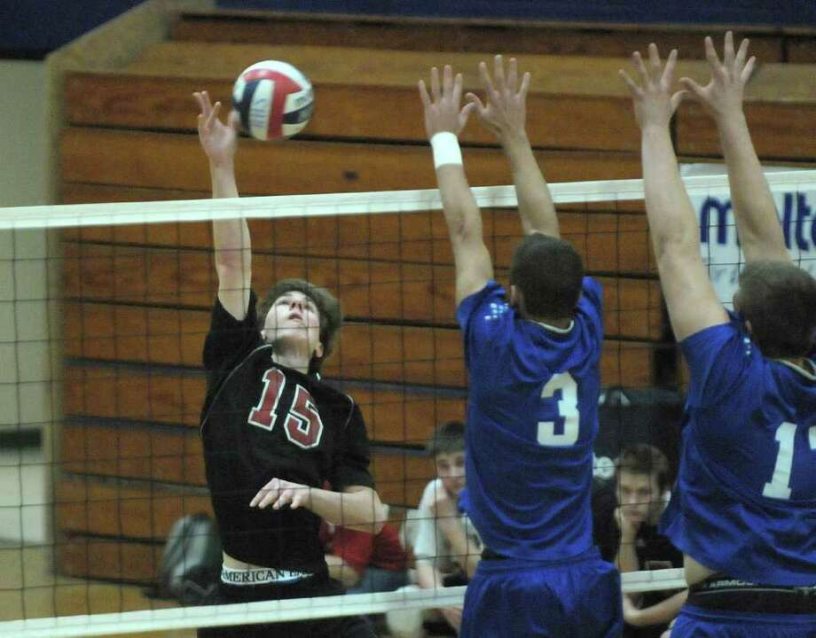Billy Bogarski, left, of Chatham goes up for the spike past  Coxsackie-Athens players during the Boy's Section II Class C/D Volleyball Championships on Sunday, March 4, 2012 at Hudson High School in Hudson, NY.  (Paul Buckowski / Times Union) Photo: Paul Buckowski