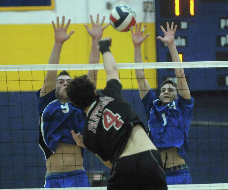 Mike Chiudina, left, and Anthony Greco, right, of Coxsackie-Athens try to block a shot by Chase Smith of Chatham during the Boy's Section II Class C/D Volleyball Championships on Sunday, March 4, 2012 at Hudson High School in Hudson, NY.  (Paul Buckowski / Times Union) Photo: Paul Buckowski