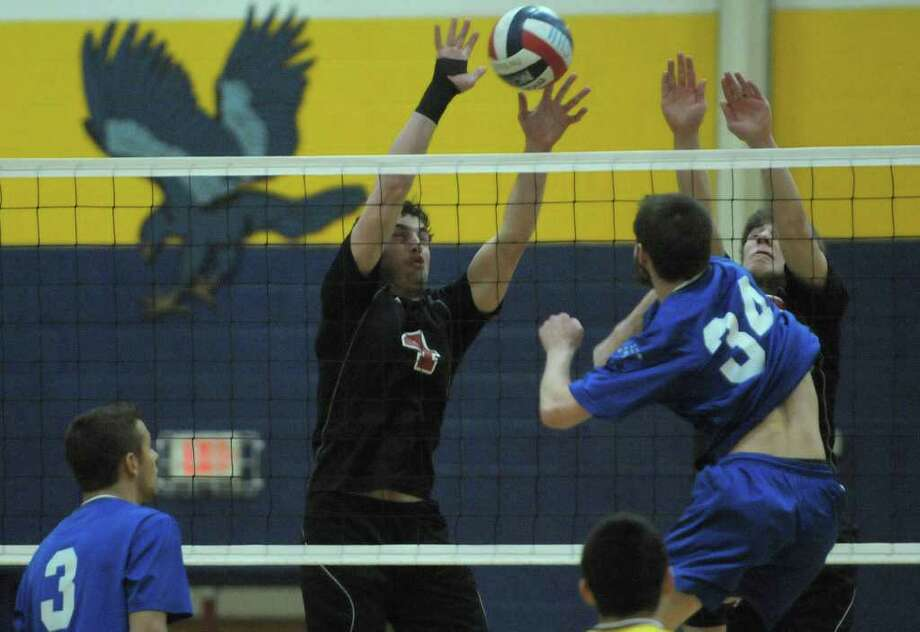 Chase Smith, left, and Billy Bogarski, right, try to block the shot of Josh Pulice of Coxsackie-Athens during the Boy's Section II Class C/D Volleyball Championships on Sunday, March 4, 2012 at Hudson High School in Hudson, NY.  (Paul Buckowski / Times Union) Photo: Paul Buckowski