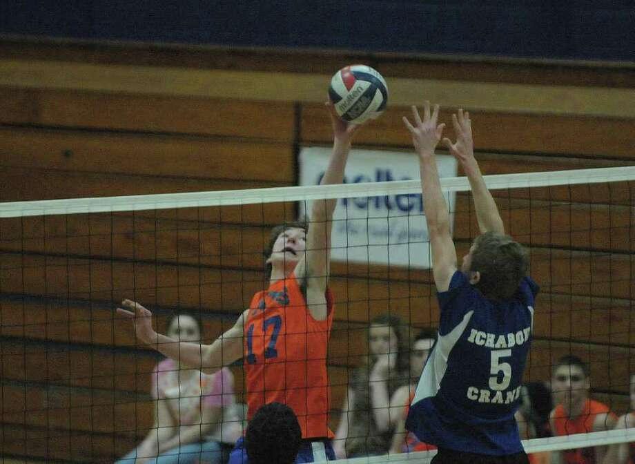 David Sira, left, of Catskill tries to get a shot past Tyler Myers of Ichabod Crane  during the Boy's Section II Class B Volleyball Championships on Sunday, March 4, 2012 at Hudson High School in Hudson, NY.  (Paul Buckowski / Times Union) Photo: Paul Buckowski
