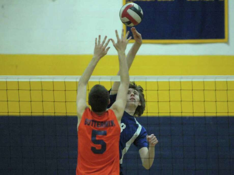 Seth Bulich, left, of Catskill, tries to block the shot of Alex Potts of Ichabod Crane during the Boy's Section II Class B Volleyball Championships on Sunday, March 4, 2012 at Hudson High School in Hudson, NY.  (Paul Buckowski / Times Union) Photo: Paul Buckowski