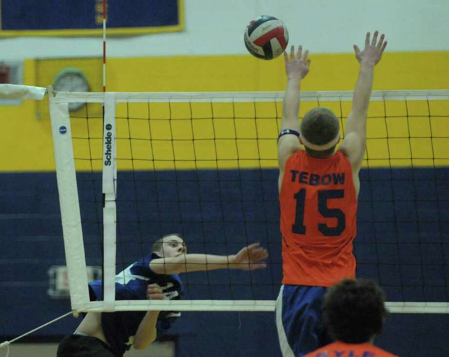 Bernie Watt, left, of Ichabod Crane tries to get a shot past Billy Meyer of Catskill during the Boy's Section II Class B Volleyball Championships on Sunday, March 4, 2012 at Hudson High School in Hudson, NY.  (Paul Buckowski / Times Union) Photo: Paul Buckowski