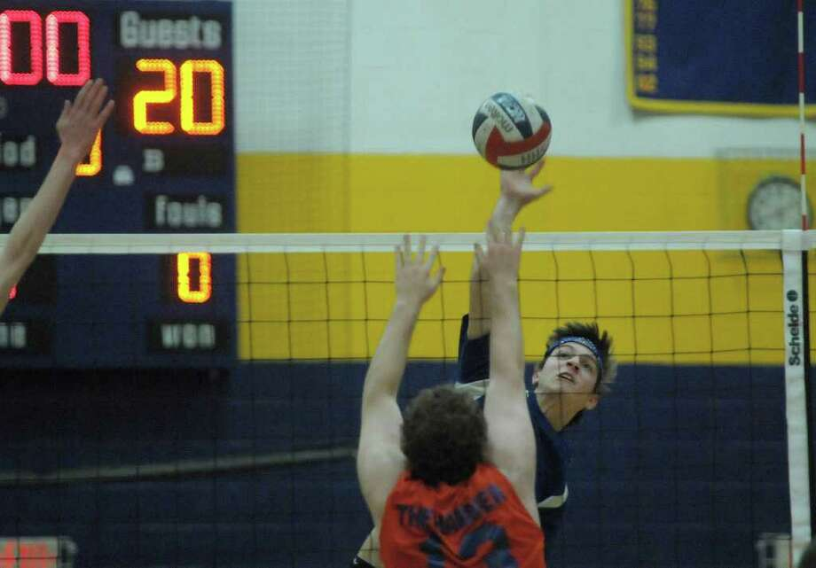 Joe Bromley, left, of Catskill, tries to block the shot of Sam Matacchiero of Ichabod Crane  during the Boy's Section II Class B Volleyball Championships on Sunday, March 4, 2012 at Hudson High School in Hudson, NY.  (Paul Buckowski / Times Union) Photo: Paul Buckowski
