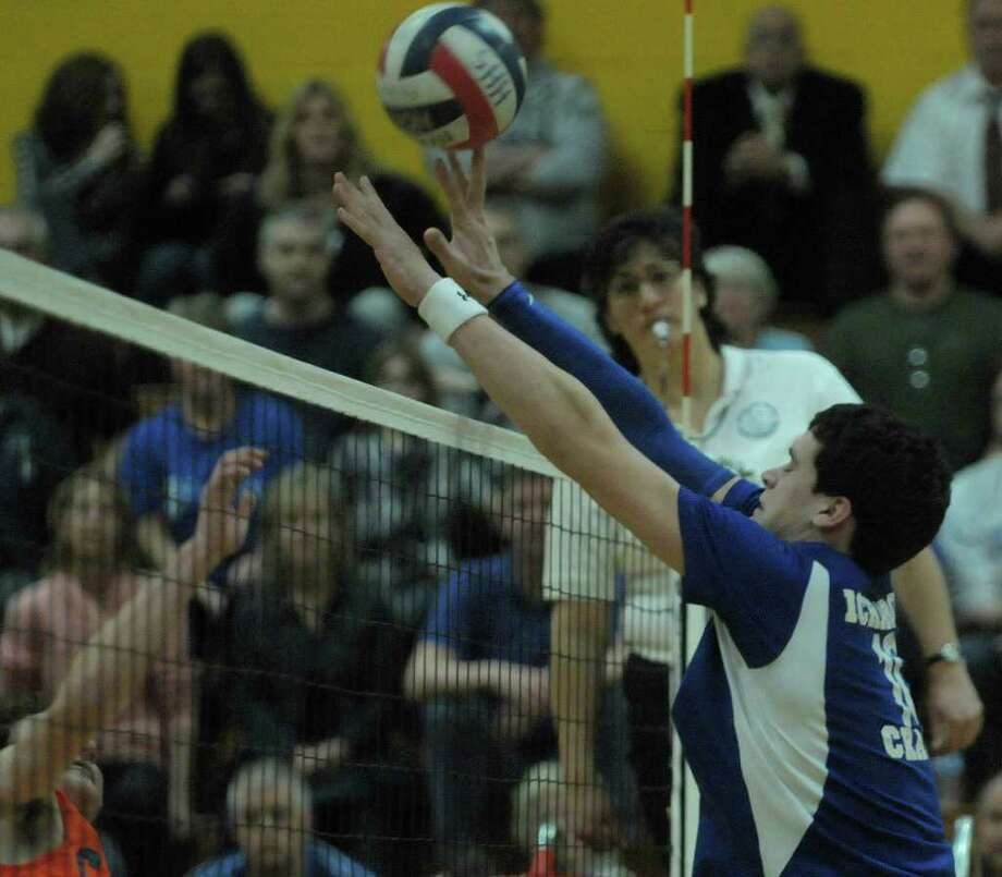 Jake Gulisane of Ichabod Crane tries to block a shot during the Boy's Section II Class B Volleyball Championships on Sunday, March 4, 2012 at Hudson High School in Hudson, NY.  (Paul Buckowski / Times Union) Photo: Paul Buckowski