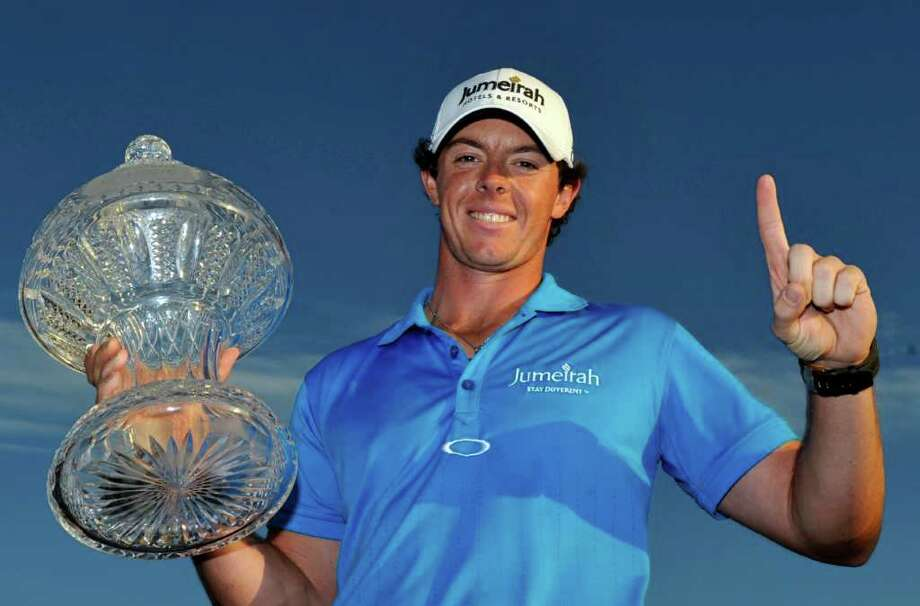 Rory McIlroy holds the trophy after winning the Honda Classic golf tournament in Palm Beach Gardens, Fla., Sunday, March 4, 2012. McIlroy became the top-ranked golfer in the world. (AP Photo/Rainier Ehrhardt) Photo: Rainier Ehrhardt