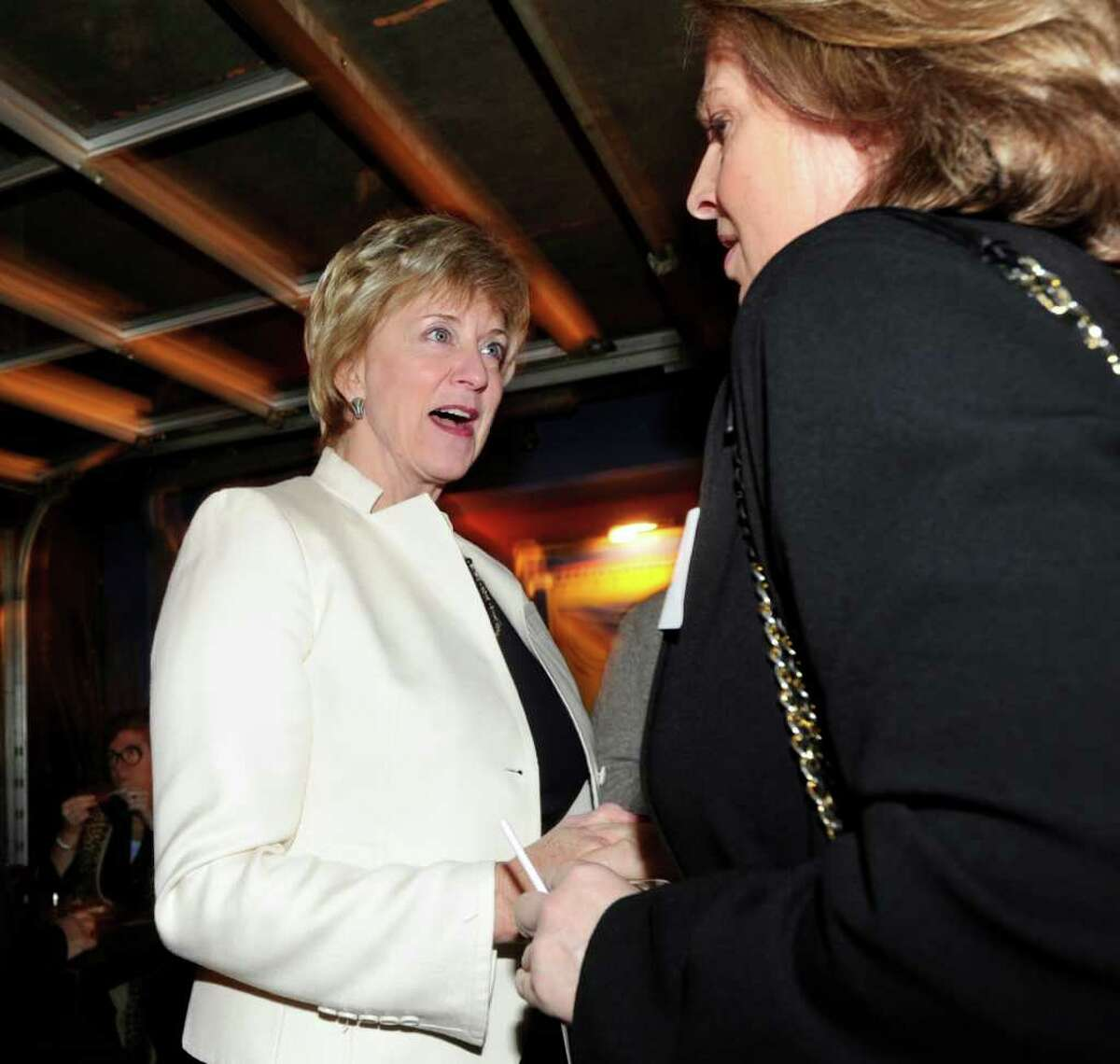 Republican U.S. Senate candidate Linda McMahon, left, meets Clare Powell of Stamford during an appearance in Stamford Feb. 2, 2012.
