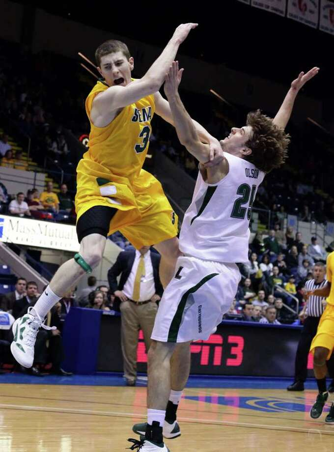 3/4/12 MassMutual Center, Springfield - Republican staff photo by Michael Beswick - The MAAC Semi-Finals were held at the MassMutual Center in Springfield Sunday.  Trying to reach the finals is New York's Siena and Maryland's Loyola.  Here, Siena's (3) Kyle Downey is up for two and draws a foul from Loyola's (25) Robert Olson.