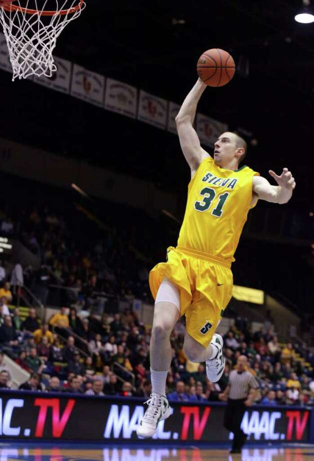 3/4/12 MassMutual Center, Springfield - Republican staff photo by Michael Beswick - The MAAC Semi-Finals were held at the MassMutual Center in Springfield Sunday.  Trying to reach the finals is New York's Siena and Maryland's Loyola.  Here, Siena's (31) Owen Wignot slams the first point for Siena.