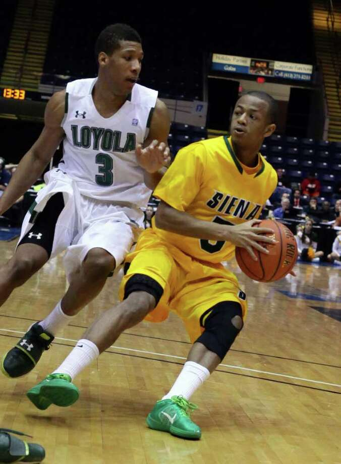3/4/12 MassMutual Center, Springfield - Republican staff photo by Michael Beswick - The MAAC Semi-Finals were held at the MassMutual Center in Springfield Sunday.  Trying to reach the finals is New York's Siena and Maryland's Loyola.  Here, Siena's (5) Evan Hymes looks to loose the coverage of Loyola's (3) Dylon Cormier.
