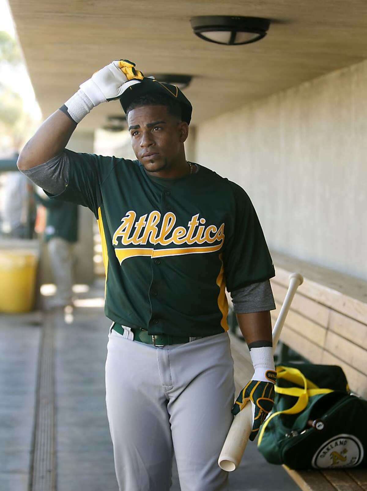 Yoenis Cespedes gets ready to take batting practice in his first workout at the Oakland A's camp in Phoenix, Ariz. on Sunday, March 4, 2012. Cespedes, who defected from Cuba last year, signed a four-year contract with Oakland.