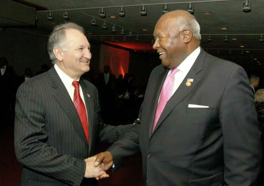 Albany, NY - February 19, 2012 - (Photo by Joe Putrock/Special to the Times Union) - 2012 US Senate hopeful George Maragos, left,  greets Jim Garner during the NYS Black & Puerto Rican Caucus. Photo: Joe Putrock / Joe Putrock
