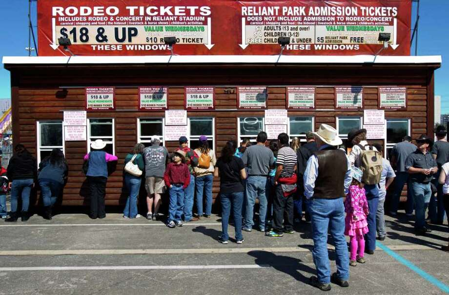 Customers line up to purchase tickets at the Houston Livestock Show and Rodeo on Sunday. Photo: Cody Duty / © 2011 Houston Chronicle