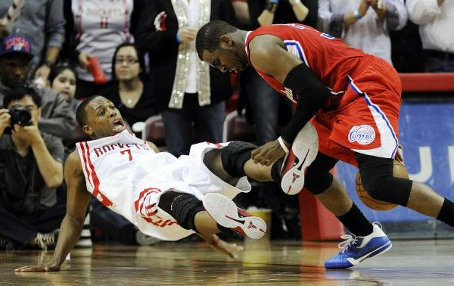 March 4: Clippers 105, Rockets 103 (OT) Rockets guard Kyle Lowry, left, hits the floor as Clippers guard Chris Paul, right, maintains control of the ball in the second half. (Pat Sullivan / Associated Press)