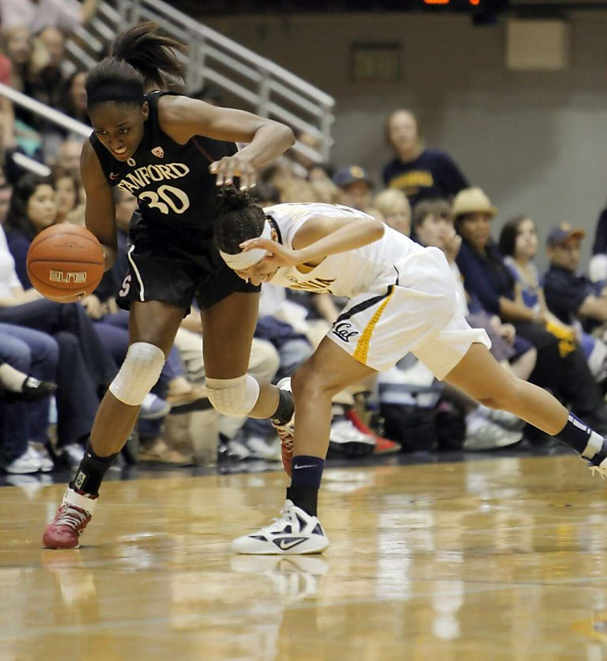 Stanford's Nnemkadi Ogwumike goes after a loose ball against Cal's Layshia Clarendon in the first half. The California women hosted Stanford at Haas Pavilion in Berkeley, Calif., on Sunday, March 4, 2012. The Golden Bears lost to the Cardinal 86-61.