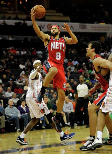 The Nets' Deron Williams found several holes in the Bobcats' defense en route to 57 points Sunday. Photo: David T. Foster III / Charlotte Observer