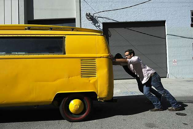 Brandon Allen and Bo Silliman push the company's VW bus back into their garage space.  The bus had been used for distribution until it was broken into and rendered inoperable.SLOdown Wine Co. in San Francisco Saturday Feb. 25th, 2012 Photo: Michael Short, Special To The Chronicle