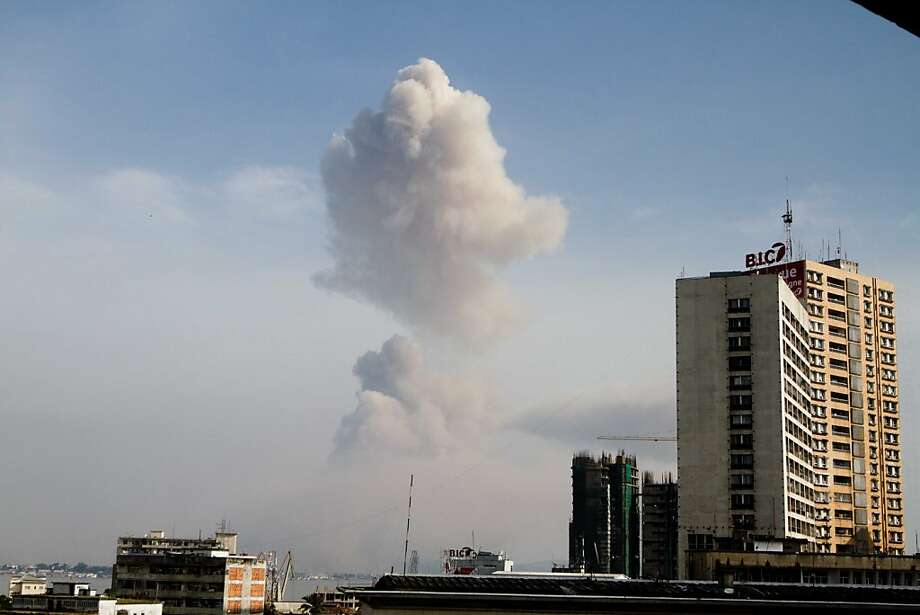 A plume of smoke can be seen over Brazzaville from across the Congo River in Kinshasa, capital of neighbouring Democratic Republic of Congo. on March 4, 2012.  A diplomatic source in the Congolese capital contacted by AFP said the blasts came from a munitions depot in the east of the city. There was no official word from Brazzaville on the cause of the explosions, or damage sustained. AFP PHOTO/Marc Hofer (Photo credit should read MARC HOFER/AFP/Getty Images) Photo: Marc Hofer, AFP/Getty Images
