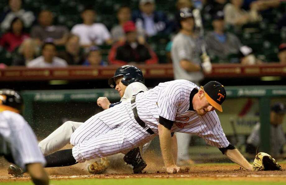 Michael Ratterree slides under Tennessee's Nick Blount to score in the second. Photo: Cody Duty / © 2011 Houston Chronicle
