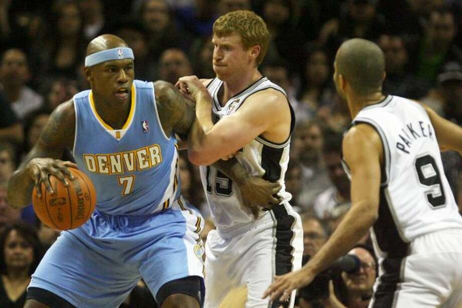 Matt Bonner guards Denver's Al Harrington in the first half Spurs vs Nuggets, Sunday, March 4, 2012. (JENNIFER WHITNEY) (special to the Express-News)