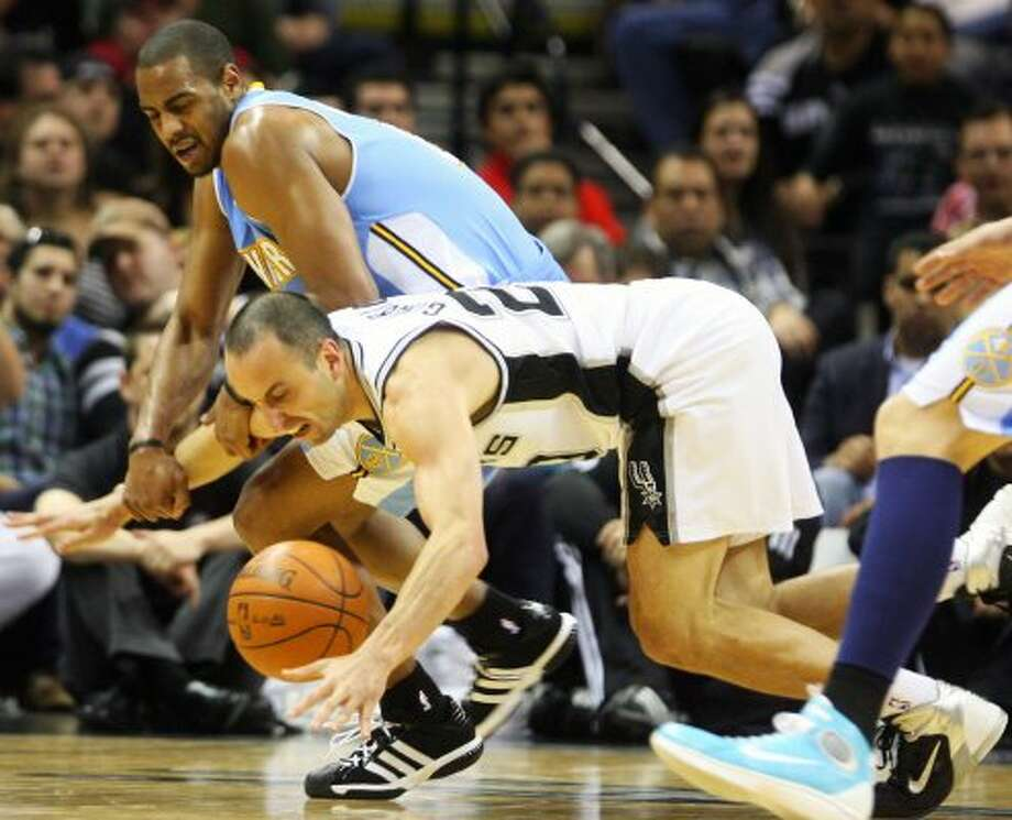 Manu Ginobili tries to maintain control of the ball in the first half Spurs vs Nuggets, Sunday, March 4, 2012. (JENNIFER WHITNEY) (special to the Express-News)