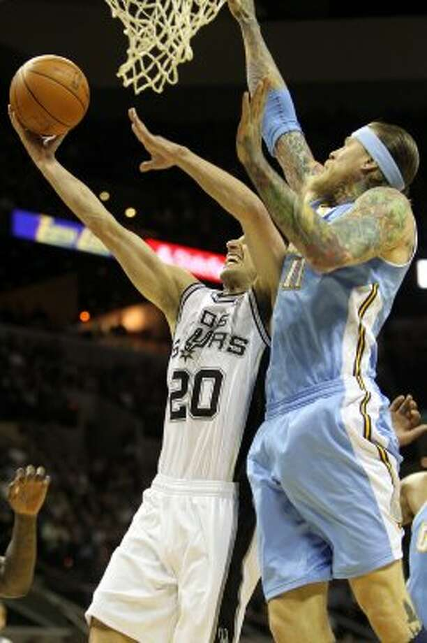 Mnu Ginobili shoots guarded by Dnever's Chris Andersen in the first half Spurs vs Nuggets, Sunday, March 4, 2012. (JENNIFER WHITNEY) (special to the Express-News)
