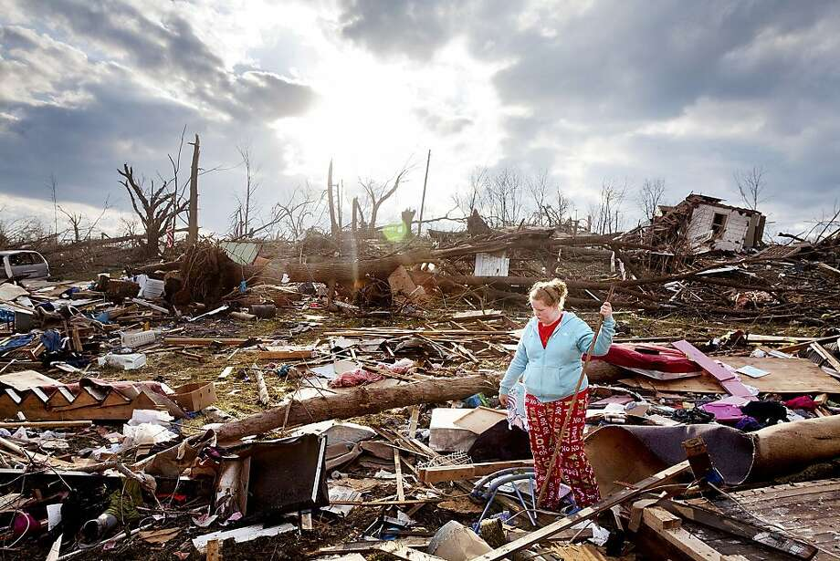 Mindy Nye, 18, of Henryville, Ind., looks through the debris on Sunday, March 4, 2012, for her 18-month-old son Nathan's baby book, after a tornado destroyed her home on Saturday. (AP Photo/Lincoln Journal Star, Brynn Anderson) Photo: Brynn Anderson, Associated Press