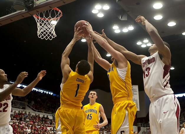 Stanford and Cal players clash in the air for the ball during the game on Sunday at Maples Pavilion. The Stanford Cardinals defeated Cal Bears in a close game on Sunday at the Maples Pavilion in Stanford. Photo: Kevin Johnson, The Chronicle