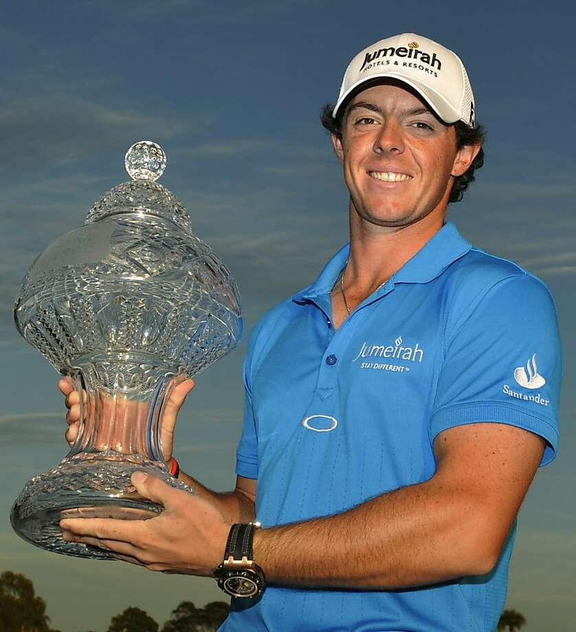 Rory McIlroy, of Northern Ireland, holds the trophy after winning the Honda Classic golf tournament in Palm Beach Gardens, Fla., Sunday, March 4, 2012. McIlroy became the top-ranked golfer in the world. (AP Photo/Rainier Ehrhardt) Photo: Rainier Ehrhardt, Associated Press
