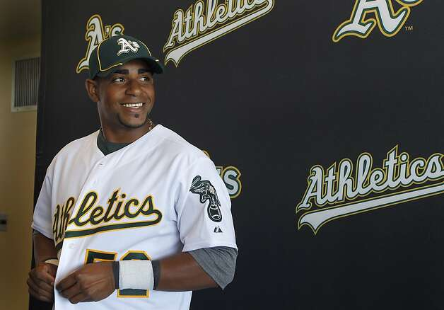 Yoenis Cespedes smiles at a news conference to announce his arrival at the Oakland A's camp in Phoenix, Ariz. on Sunday, March 4, 2012. Cespedes, who defected from Cuba last year, signed a four-year contract with Oakland. Photo: Paul Chinn, The Chronicle