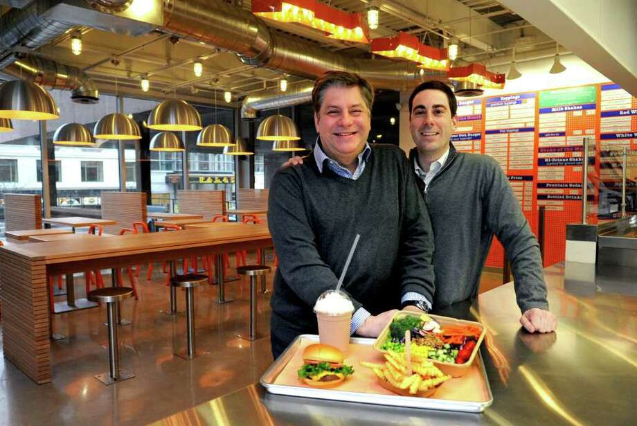 Nicholas Type, left, and Seth Leifer, right, Co-Owners of Station Eats in Stamford, pose for a photo in their restaurant on Friday, February 24, 2012. Photo: Lindsay Niegelberg / Stamford Advocate