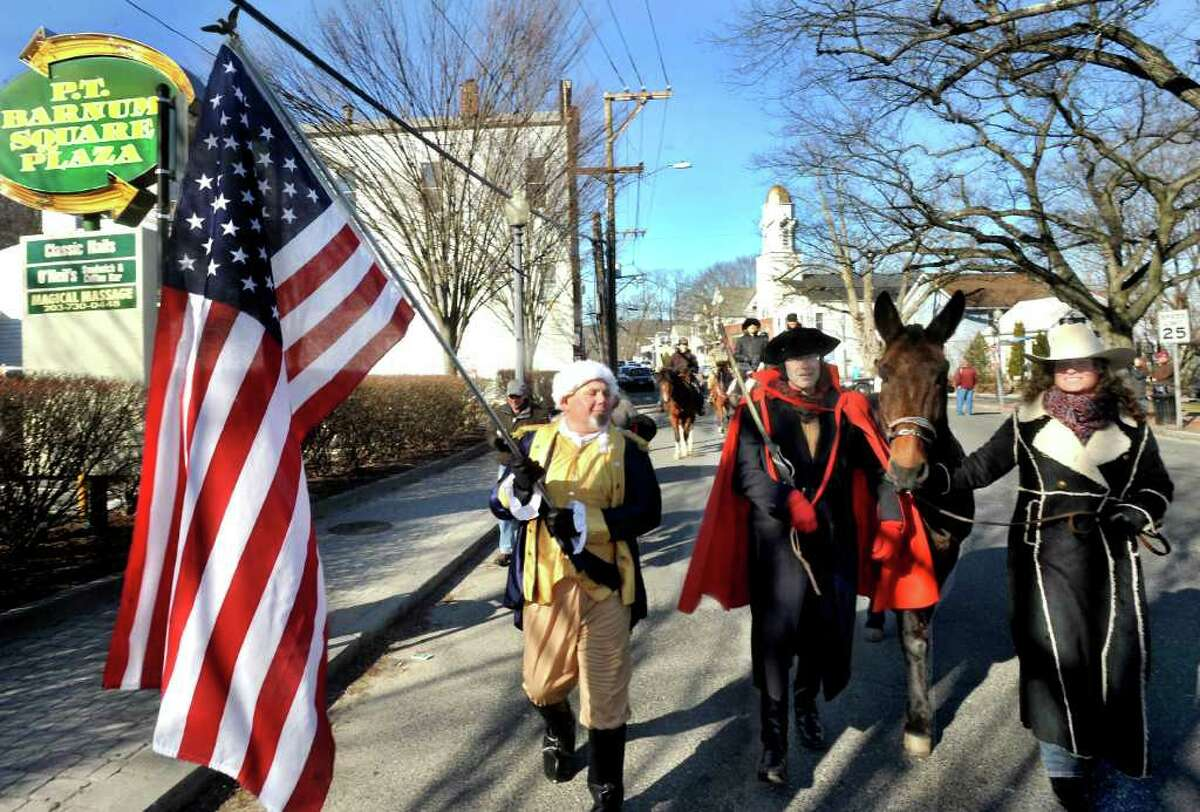 John Opinski, left, Billy Michael, the mule Lollipop, and Kim Macey, Lollipop's owner, lead the first Pulaski Day Parade on Greenwood Avenue in Bethel Monday, March 5, 2012. Casimir Pulaski is known as the father of the American Cavalry.