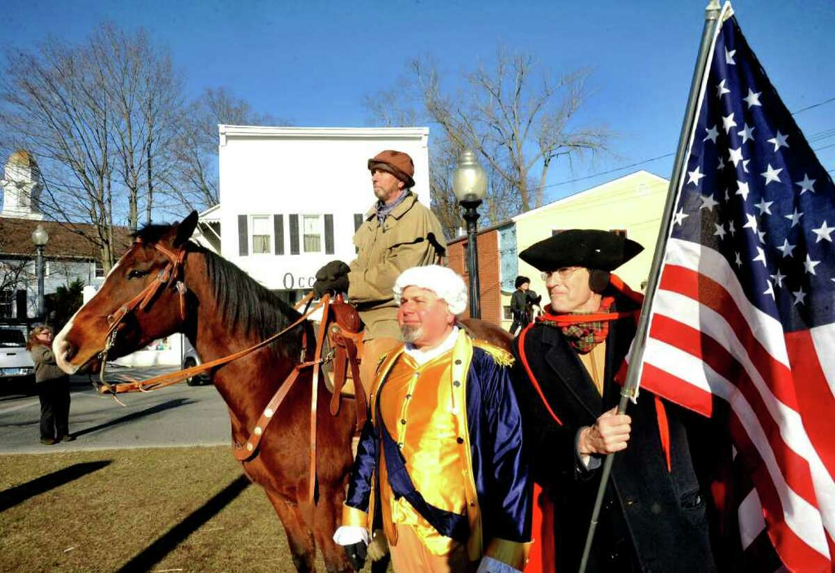 John Opinski, center, and Billy Michael, right, stand under Ed Prybylski, of Happy Trails Farm during the Pulaski Day Parade ceremonies in Bethel Monday, March 5, 2012. Casimir Pulaski is known as the father of the American Cavalry.