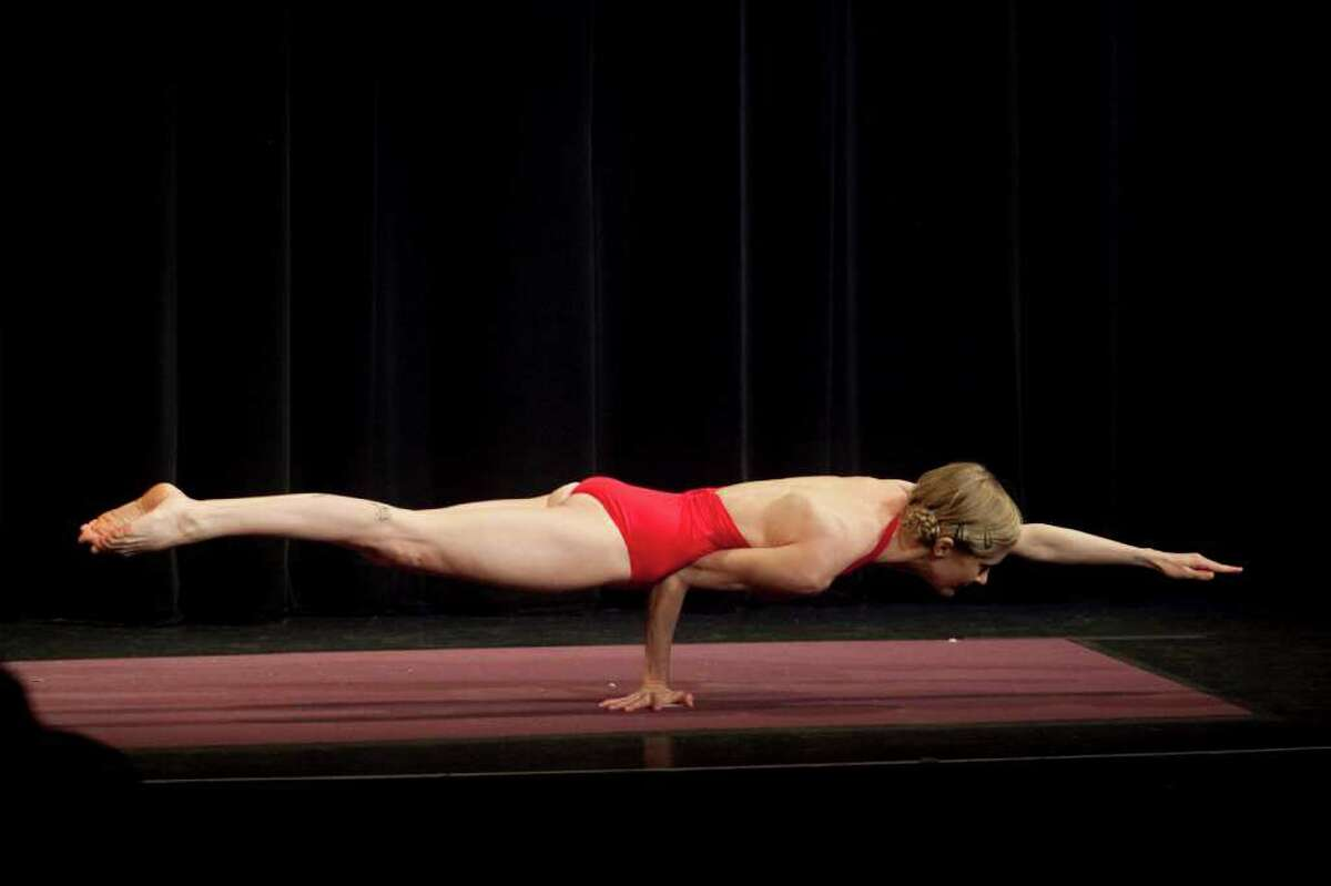 Afton Carraway, a former dancer from Orlando, Fla., who defended her women's championship, at the ninth New York Regional and National Yoga Asana Championship at the Hudson Theater in New York, March 4, 2012. The competition, hosted by the United States Yoga Federation, also known as USA Yoga, took place Friday night through Sunday afternoon. (Piotr Redlinski/The New York Times)